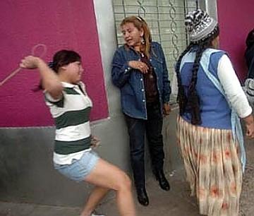 Bolivian thugette assaults an indigenous woman