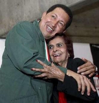 Hugo Chavez hugs Ana Maria Zapata