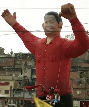 A giant Chavecito balloon hangs over a barrio in Caracas