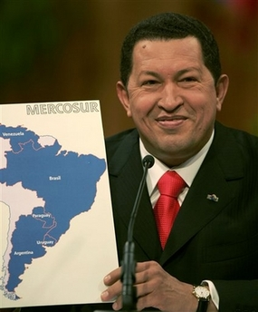 A very droll Chavecito, holding a map of Mercosur countries