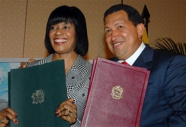 Hugo Chavez with Jamaican PM Portia Simpson Miller