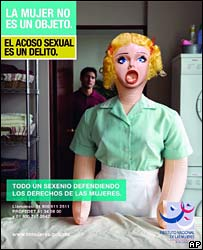 A blow-up sex doll illustrates an anti-rape campaign poster in Mexico
